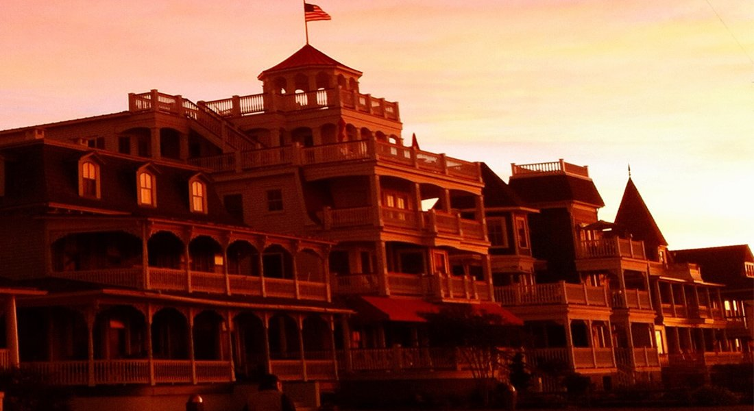 Boardwalk buildings with ornate balconies in the red sunset.