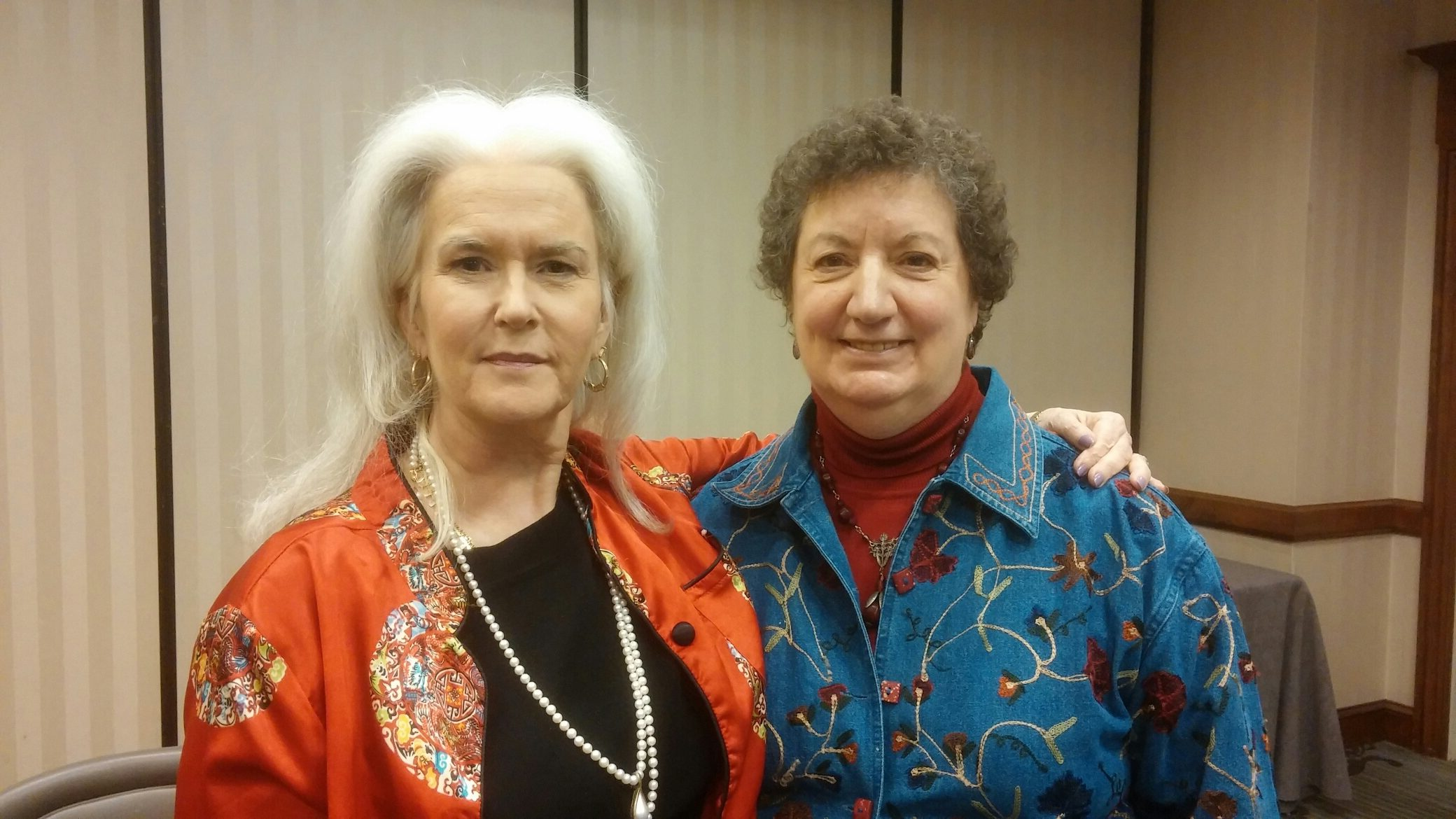 Owner Deanna Brown, woman with short brown hair and Heloise, woman with long white hair