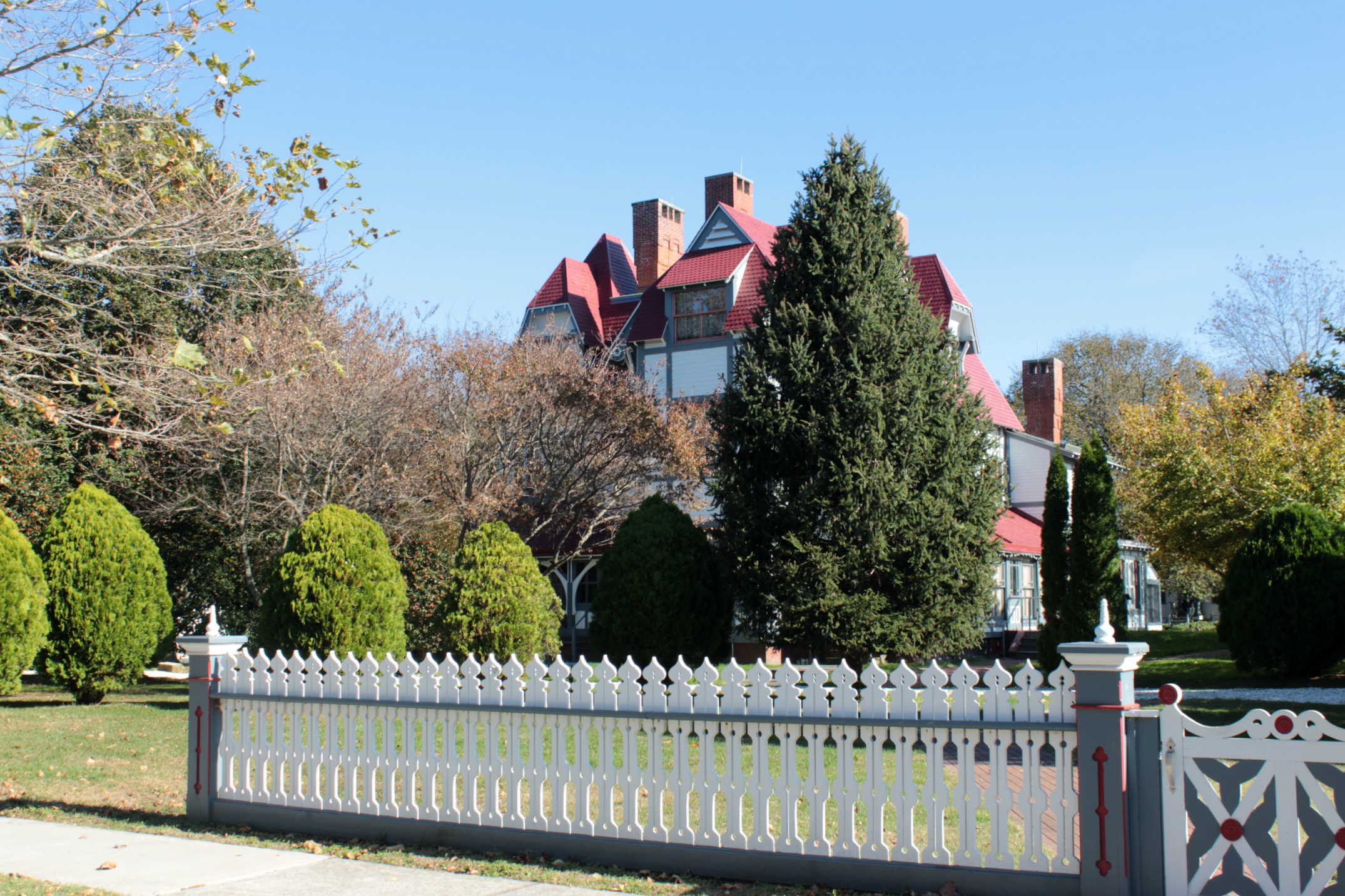 Emlen Physick Estate in Cape May, surrounded by fence and trees.