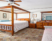 Check Availability button - a guest roomw ith a wooden canopy bed and a daybed.