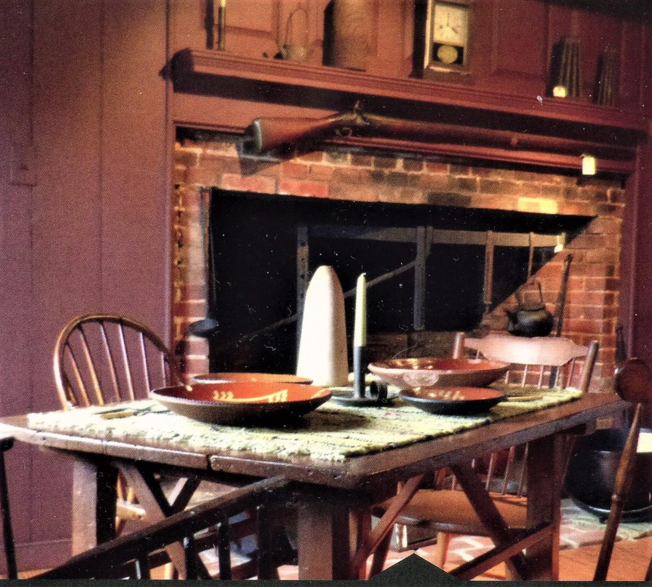 Brown table set for dinner with candles in historic building