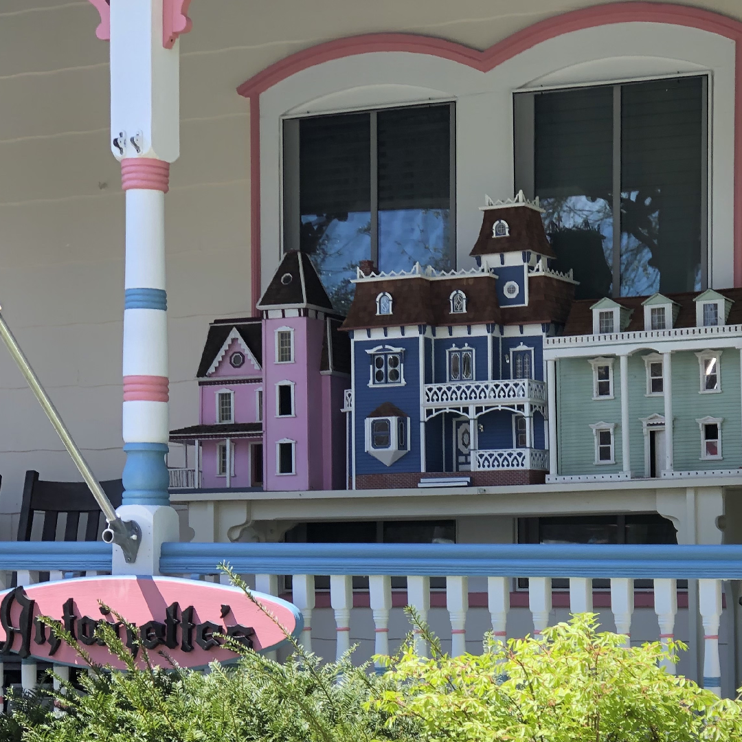 Three dollhouses on the porch at Antoinette's