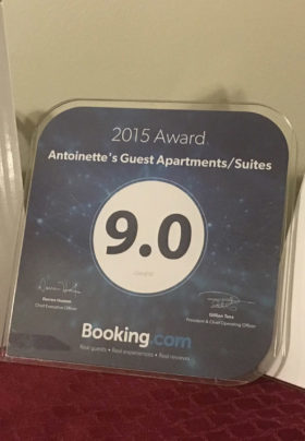 Bookings.com award plaque with a rating of 9.0
