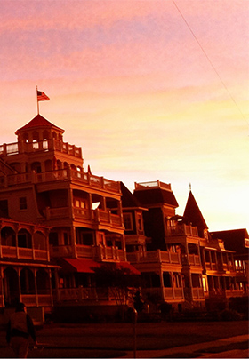 Ornate wooden building with many balconies at sunset in Cape May