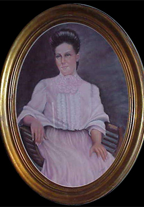 Portait of a woman with brown hair and a pink dress in an oval gold frame